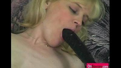 Blonde chick playing with long dildo on couch